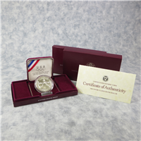 Olympic Silver Dollar Uncirculated in Box with COA  (US Mint, 1988)