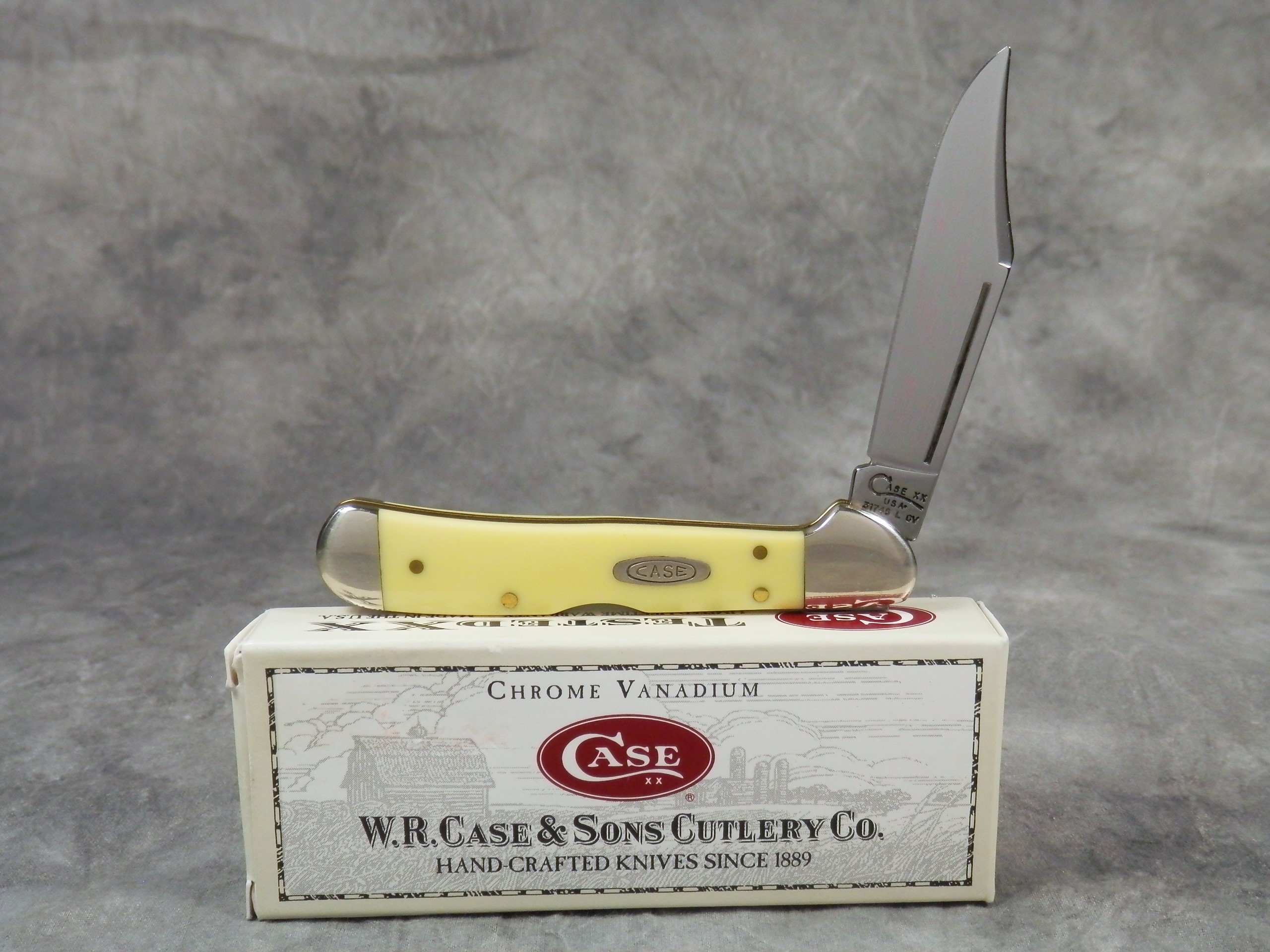 1999 case xx usa 31749l cv smooth yellow mini copperlock pocket knife current market value